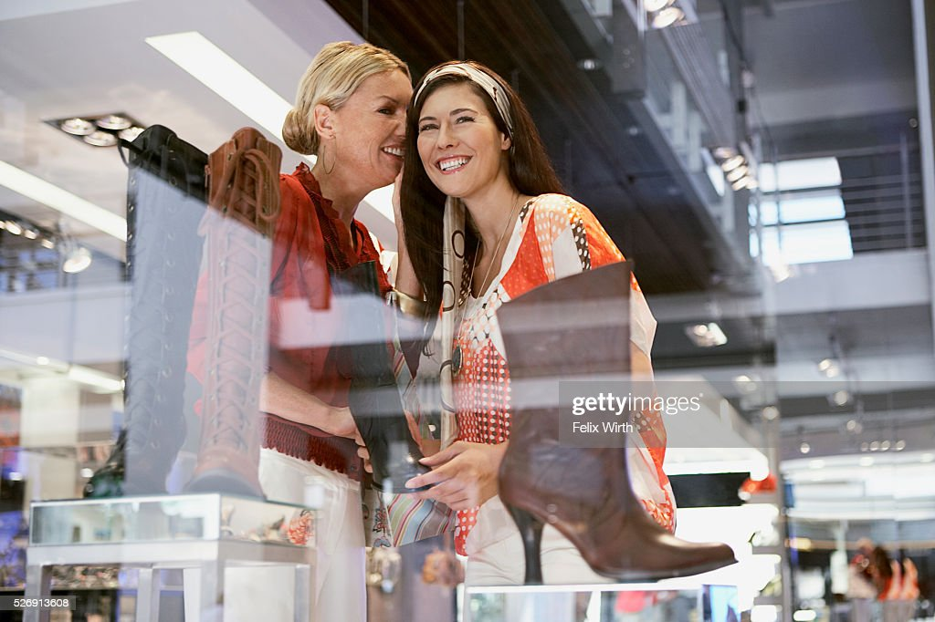 Women in shoe store : Bildbanksbilder