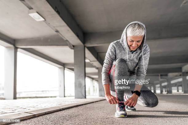 women in sport - one mature woman only stock pictures, royalty-free photos & images