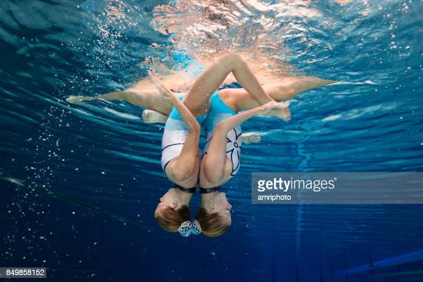 Women in Sport - snychronized swimming underwater pose