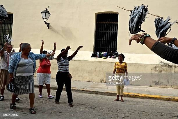 Women in the 'Circulo de Abuelos' one of many exercise groups for senior women goes through a routine in Old Havana on November 12 2012 in Havana...