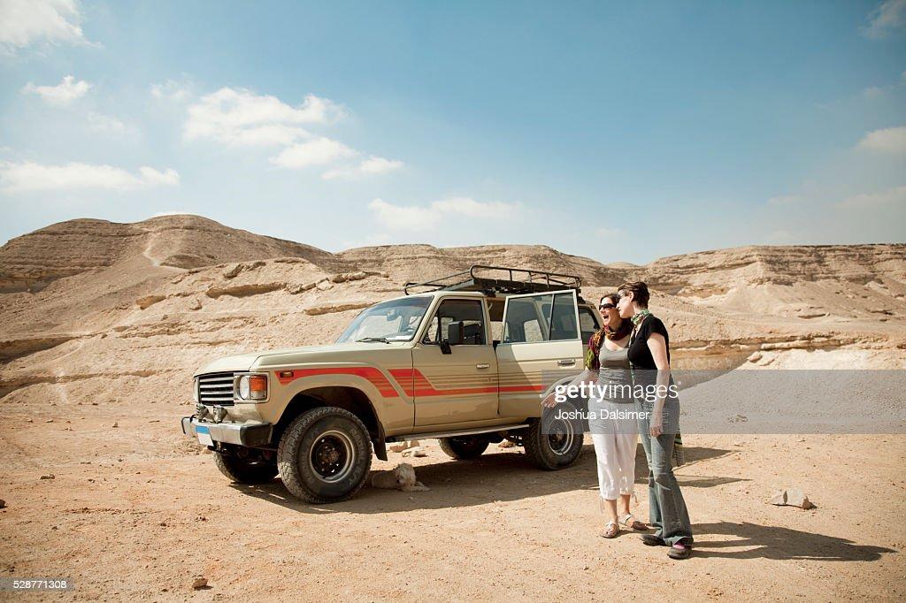 Women in the desert : Stock Photo