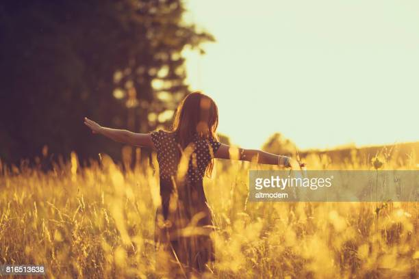 women in the evening sky in a meadow - zen like stock pictures, royalty-free photos & images