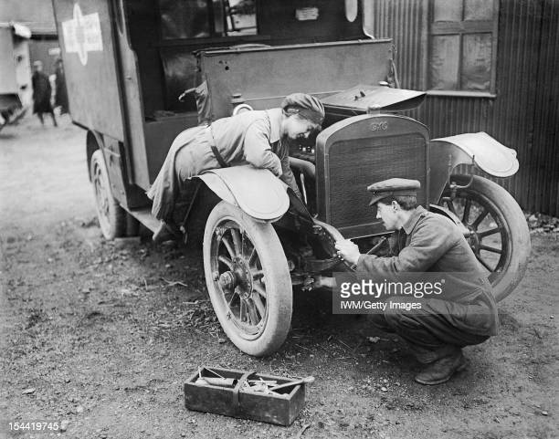 Women In The First World War An ambulance driver of the First Aid Nursing Yeomanry assists with the maintenance of her vehicle at St Omer 28 February...