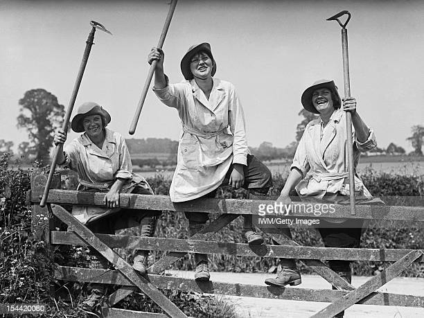 Women In The First World War Three members of the Women's Land Army raise their hoes in salute circa 1918