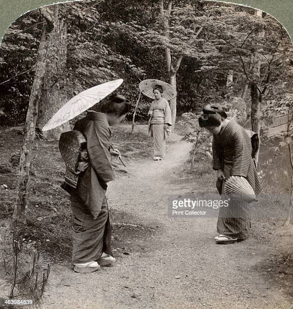 Women in the Kinkakuji Temple garden Kyoto Japan 1904 The Kinkakuji is a Buddhist temple originally founded in 1397 It was destroyed by fire twice...