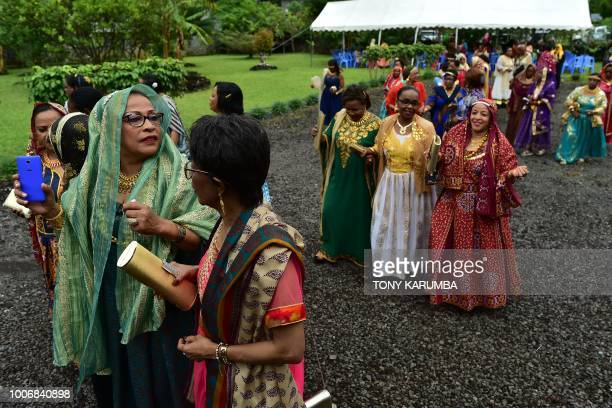 Women in their colourful garbs are pictured at a traditional wedding ceremony in Moroni on July 28 capital of the volcanic Comoros archipelago off...