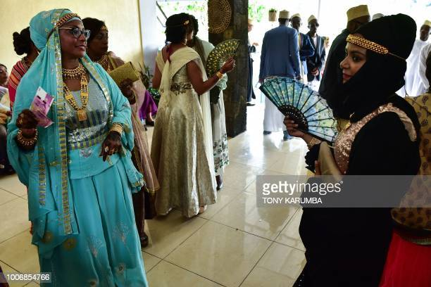 Women in their colourful garbs are pictured at a traditional wedding ceremony in Moroni July 28 capital of the volcanic Comoros archipelago off...