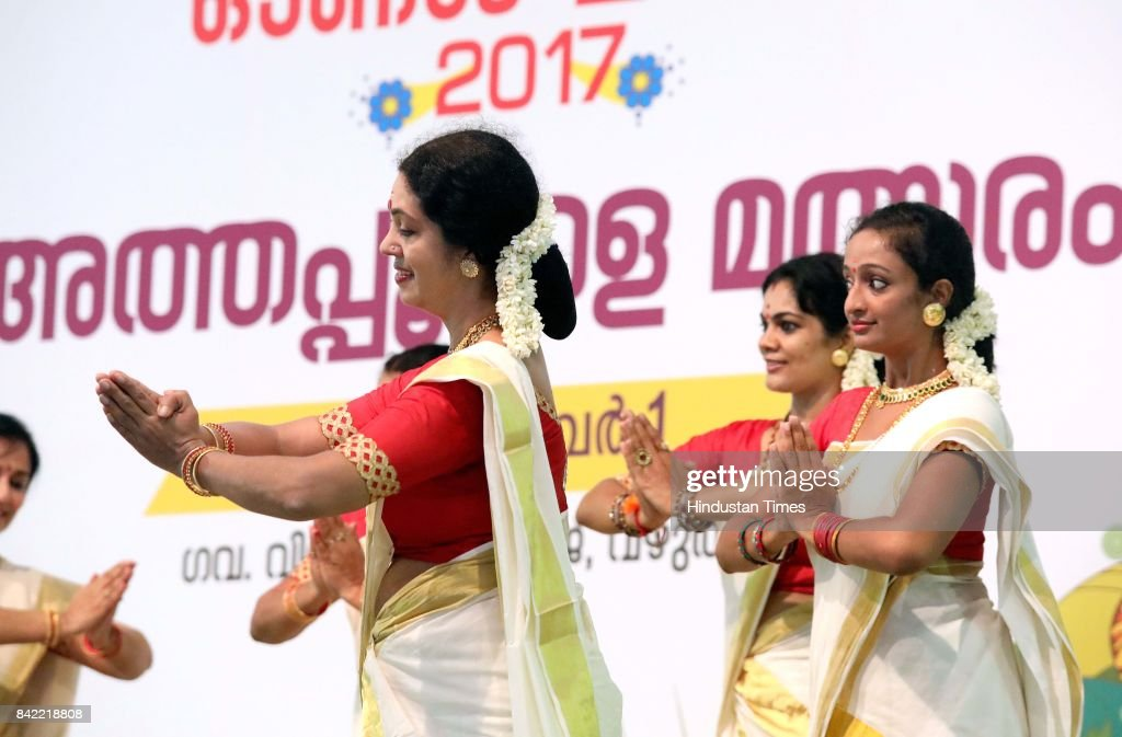 Women in their traditional attire dance to the tune of songs on the occasion of Onam festival on September 3 2017 in Kerala India Onam is an annual...