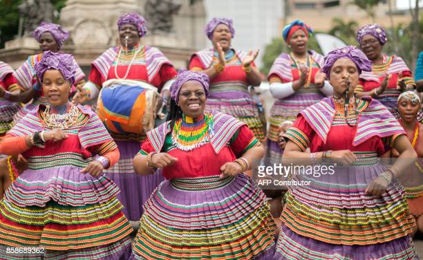 Women in their traditional Basotho outfits sing and dance in the streets during the Indoni SA Cultural Festival on October 7 2017 in Durban The...