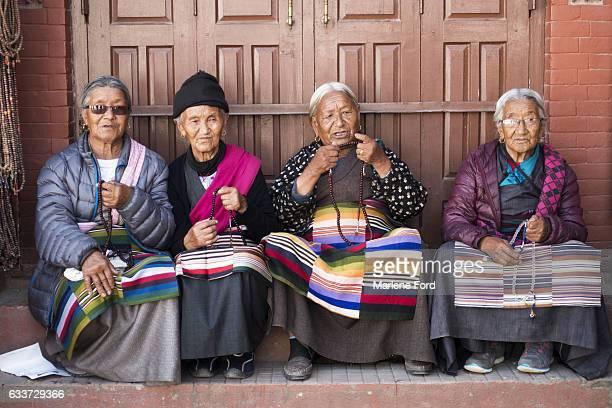 Women in Tibetan dress with mala beads