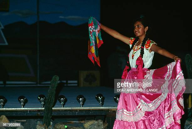 Women in traditional clothes during the performance of the Bani Stui Gulal which tells the story of the Guelaguetza festival Oaxaca Mexico