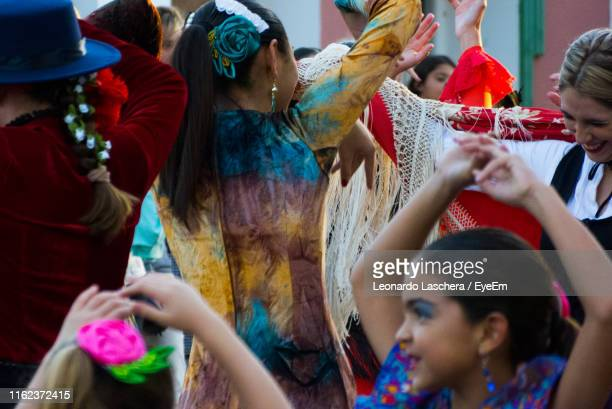 women in traditional clothing dancing outdoors - argentina traditional clothing stock photos and pictures
