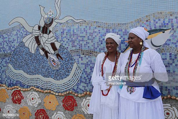 Women in traditional costumes chatting at Rio Vermelho beach to celebrate Yemanja day on February 2 2016 in Salvador Brazil Yemanja is a powerful...