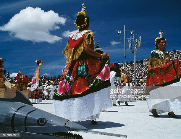 Women in traditional costumes Jarabe Mixteco dance during the celebrations at the Guelaguetza festival Oaxaca Mexico