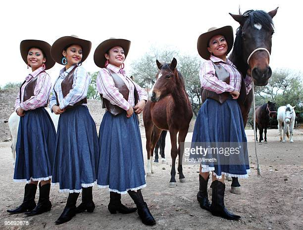 Women in traditional cowboy costumes at a wedding