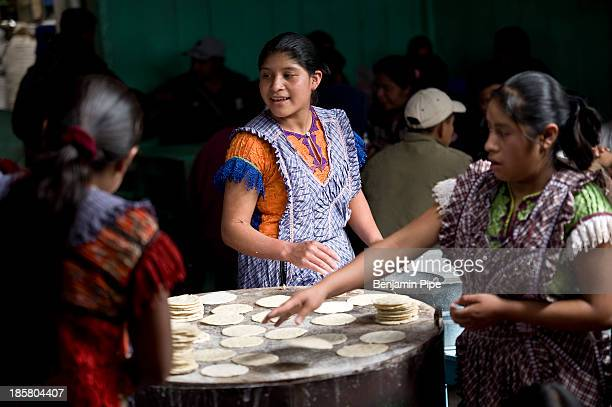 Women in traditional dress working in Market, Chichicastenango, Western Highlands, Guatemala