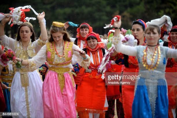 Women in traditional dresses take part in a Macedonian indigenous Juruk tribe wedding in Pochival Village near Stip Macedonia on September 9 2017...