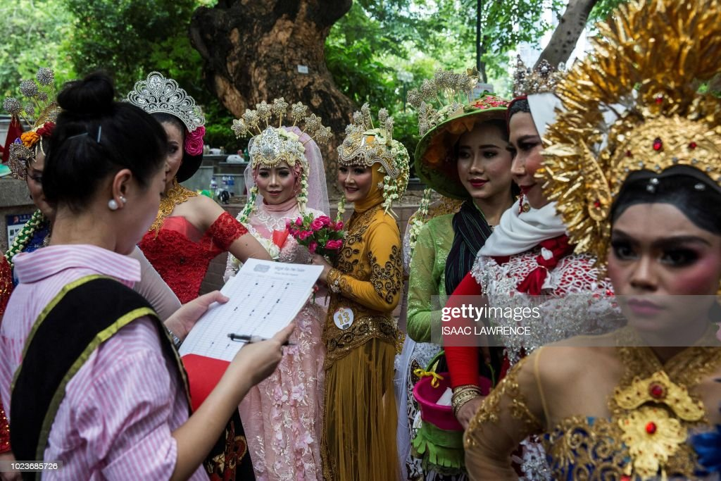 Women in traditional Indonesian dress stand to be judged during a News Photo  Getty Images
