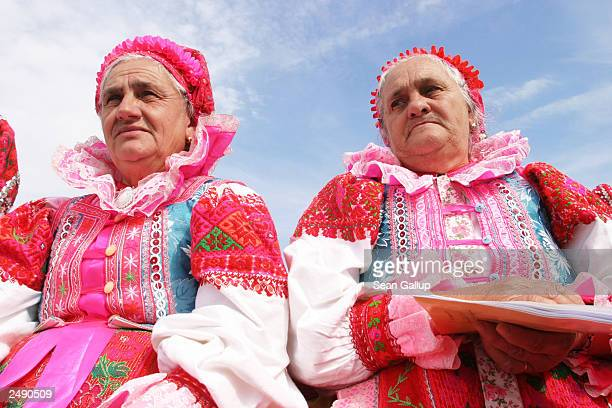 Women in traditional Slovak folk dress listen to a mass given by Pope John Paul II on September 13 2003 in the town of Roznava Slovakia The Pope is...