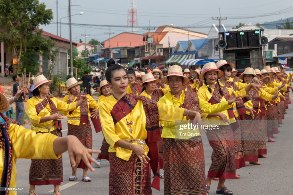 Women in traditional Thai clothes dancing in parade. : Stock Photo