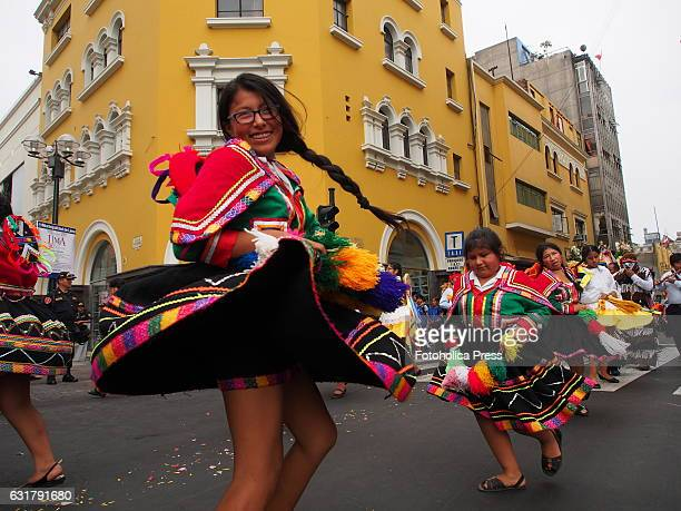 Women in typical costumes dancing in the procession. Hundreds of people accompanied the images of the Quechua-speaking vicarage of San Sebastian and...