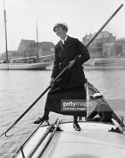 Women In Uniform During The First World War Mrs Gladys Barnes holds a large pole as she pushes her motor boat the BALMACAAN away from the shore at...