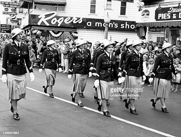 Women in uniform marching in a parade Oakland California late 1940s