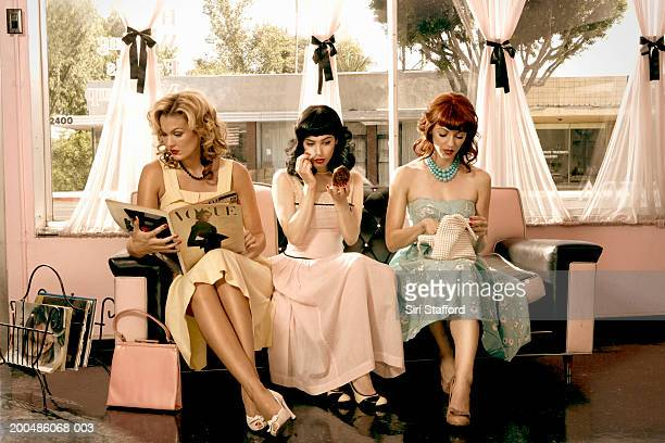 Women in vintage clothing waiting inside beauty salon
