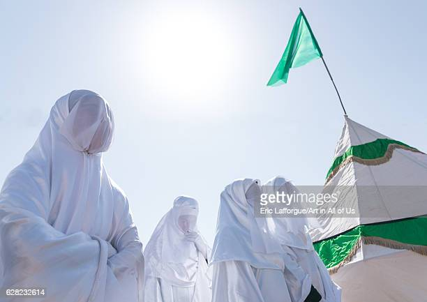 Women in white chadors during a traditional religious theatre called tazieh about Imam Hussein death in Kerbala Lorestan Province Khorramabad Iran on...
