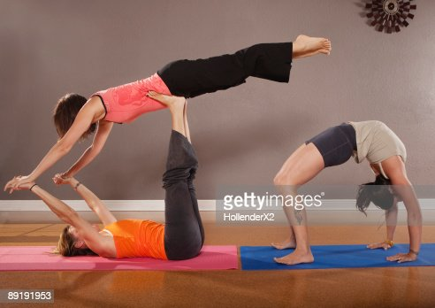 women in yoga poses highres stock photo  getty images