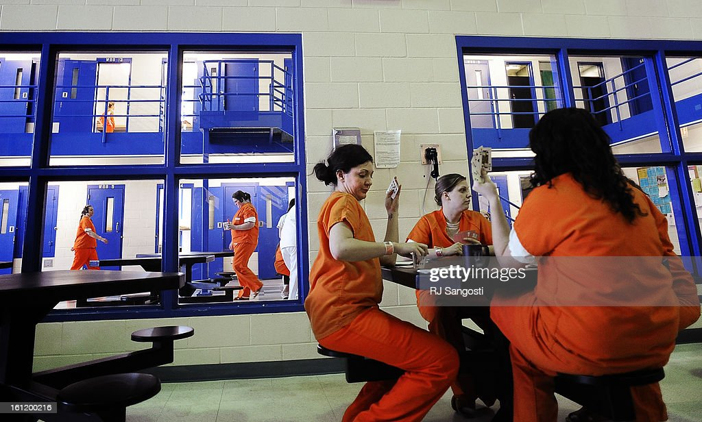 Women inmates play cards, Thursday, March 03 at the the Larimer