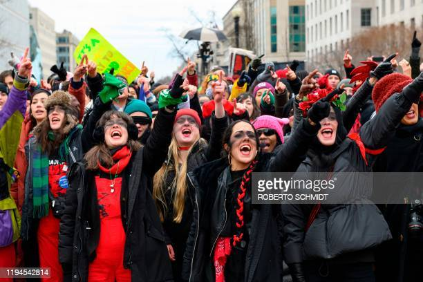 """Women inspired by the Chilean feminist group called Las Tesis dance during the 4th annual Womens March in Washington, DC, on January 18, 2020. - """"The..."""