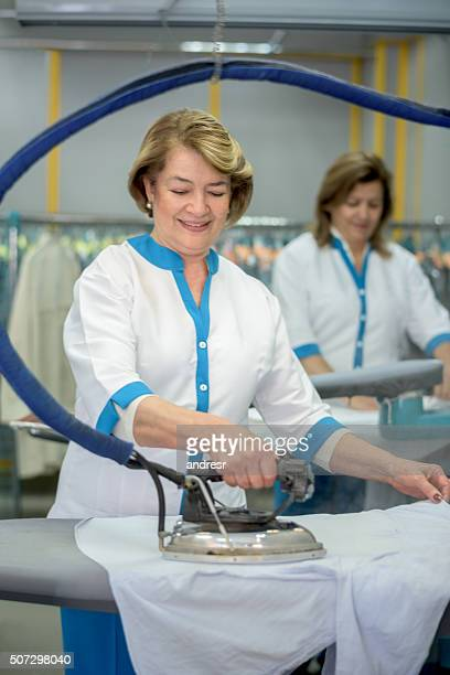 Women ironing clothes at a laundry shop