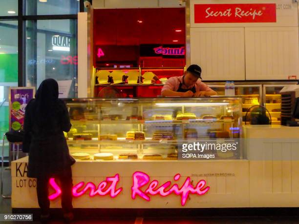 A women is seen observing some cakes at Secret Recipe while the worker is doing a paper work Kuala Lumpur or commonly known as KL is the national...