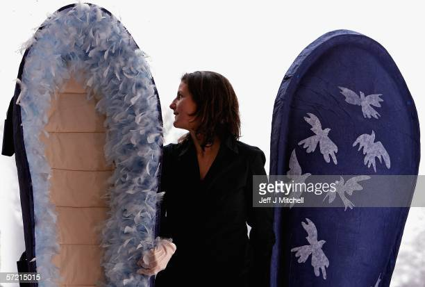 A women is seen standing beside a papier mache coffin at the opening of the Green Design and Creativity with a Consience Exhibition being held at the...