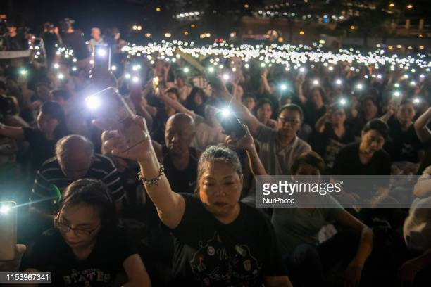 A Women is seen waving her cell phone light during a rally in Hong Kong China 5 July 2019 Thousands of Hong Kong mother gather in Chater Garden in...