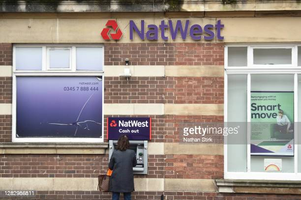 Women is seen withdrawing cash from Natwest Bank on October 30, 2020 in Newcastle-under-Lyme, England. HSBC Chief Executive Noel Quinn said the bank...