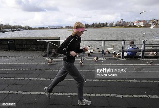 Women jog in Reykjavik center on April 21 2009 Iceland's interim leftwing government looks set to win the country's forthcoming elections according...