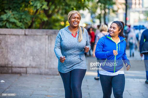 women jogging in central park new york - big beautiful black women stock photos and pictures