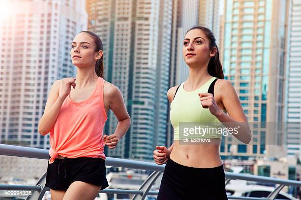Women jogging in Dubai Marina.