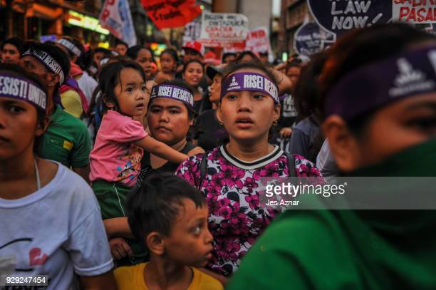 Women join a protest march for International Women's Day on March 8 2018 in Manila Philippines Protesters marched on the streets of the nation's...