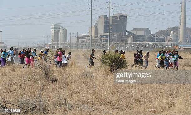 Women join the mine workers as they protest outside the Nkageng informal settlement on August 16 2012 in North West South Africa At least 10 people...