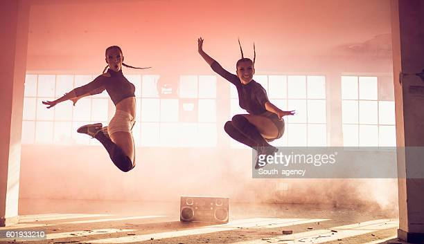 Women jumping in pink smoke
