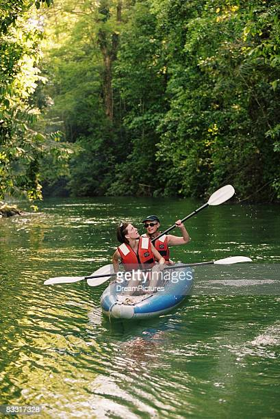 women kayaking along river  - guanacaste stock pictures, royalty-free photos & images