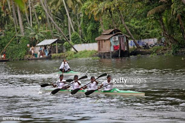 Women Kayaking in Punnamada Lake at Alleppey, Kerala, India
