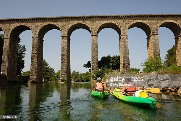 Women kayaking the Sorgue river in Provence