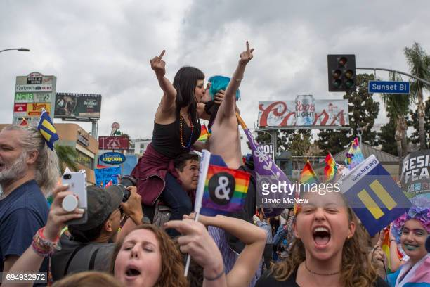 Women kiss in defiance of hateful speech from provocative street preachers at the #ResistMarch during the 47th annual LA Pride Festival on June 11 in...