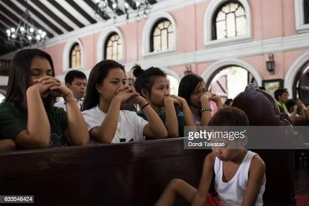 Women kneel in prayer during a mass held for victims of the drug war on February 2, 2017 in Manila, Philippines. Philippine president Rodrigo Duterte...