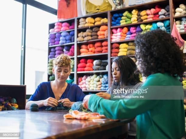 Women knitting in yarn store