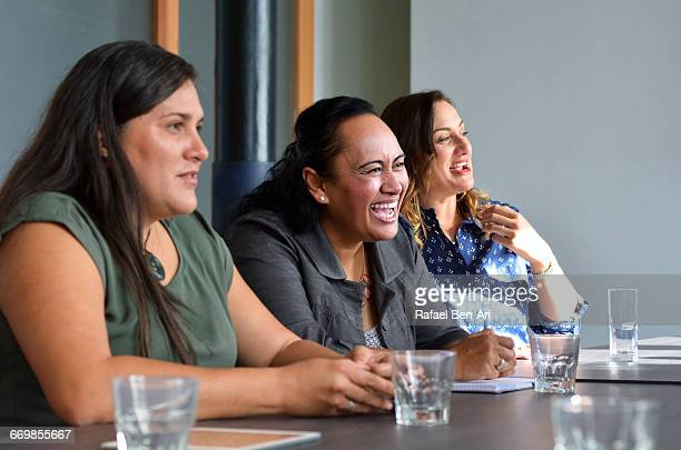 Women Laugh During a Business Meeting